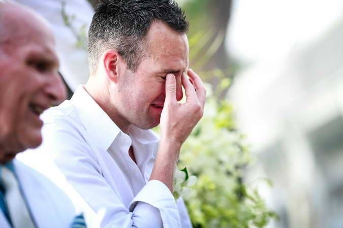 The groom crying at the first meet his beautiful bride when walk down the aisle to him at Kata Phuket Beach resort wedding venue